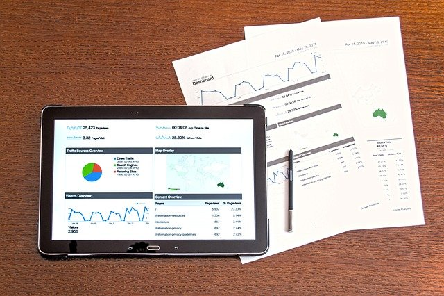 A webpage showing on a tablet and paperwork on a desk