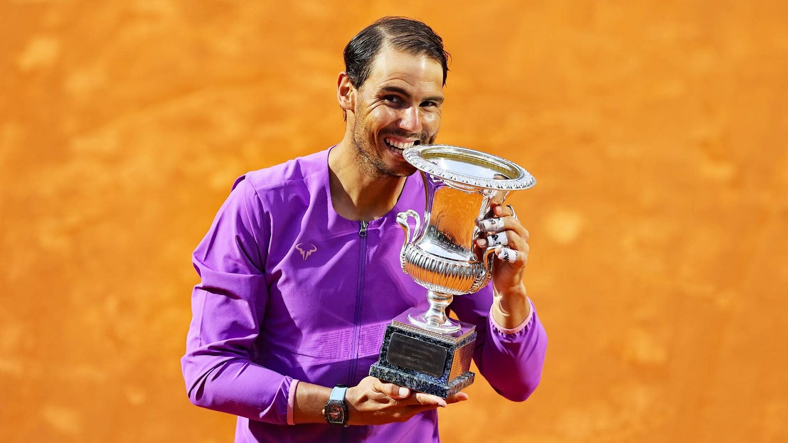 Rafael Nadal winning the French Open trophy in 2020
