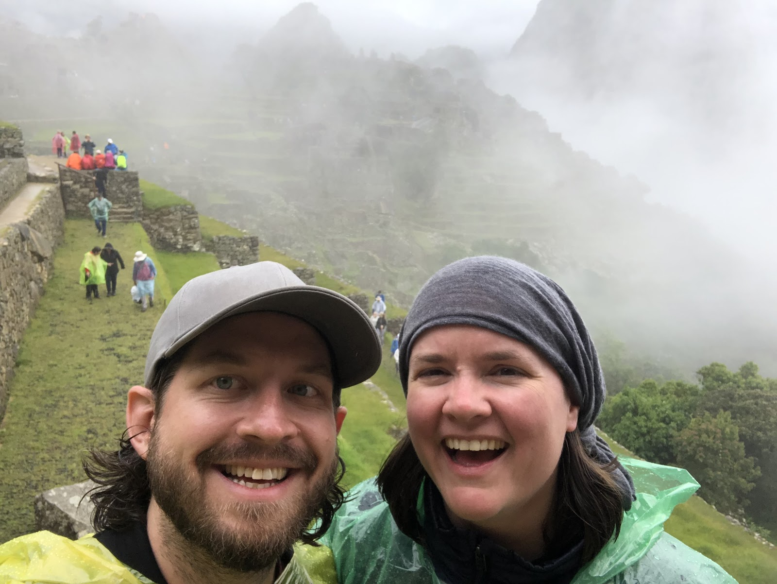 1SE team members Sami and Megan smile at the foggy summit of the Inca Trail in Peru.
