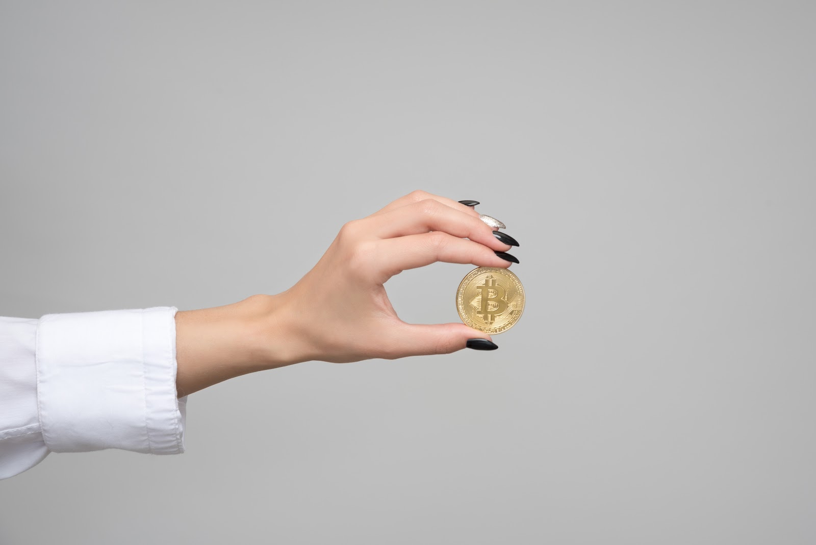 woman holding bitcoin gold
