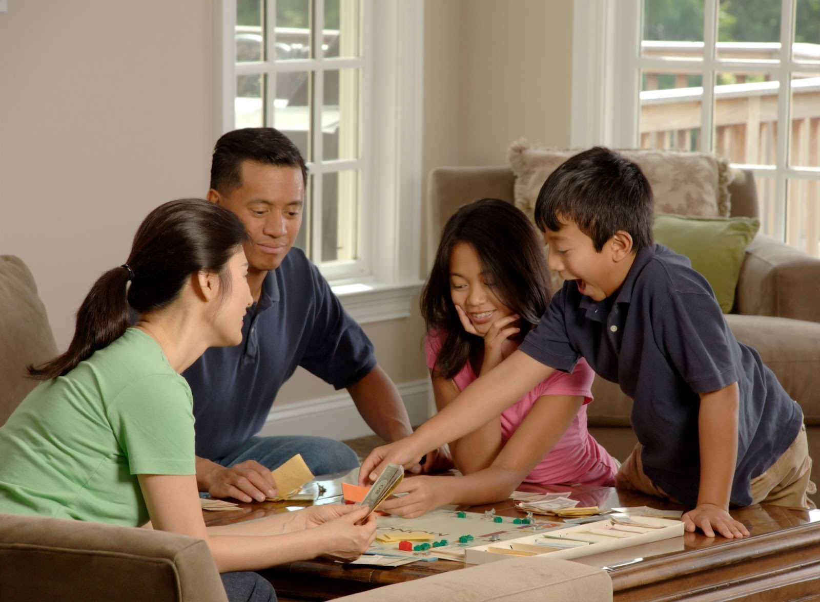 family playing in the living room