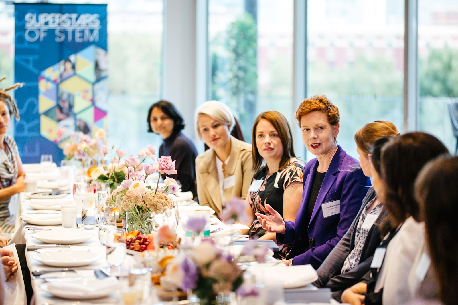 Photos of event attendees at the Women in STEM breakfast