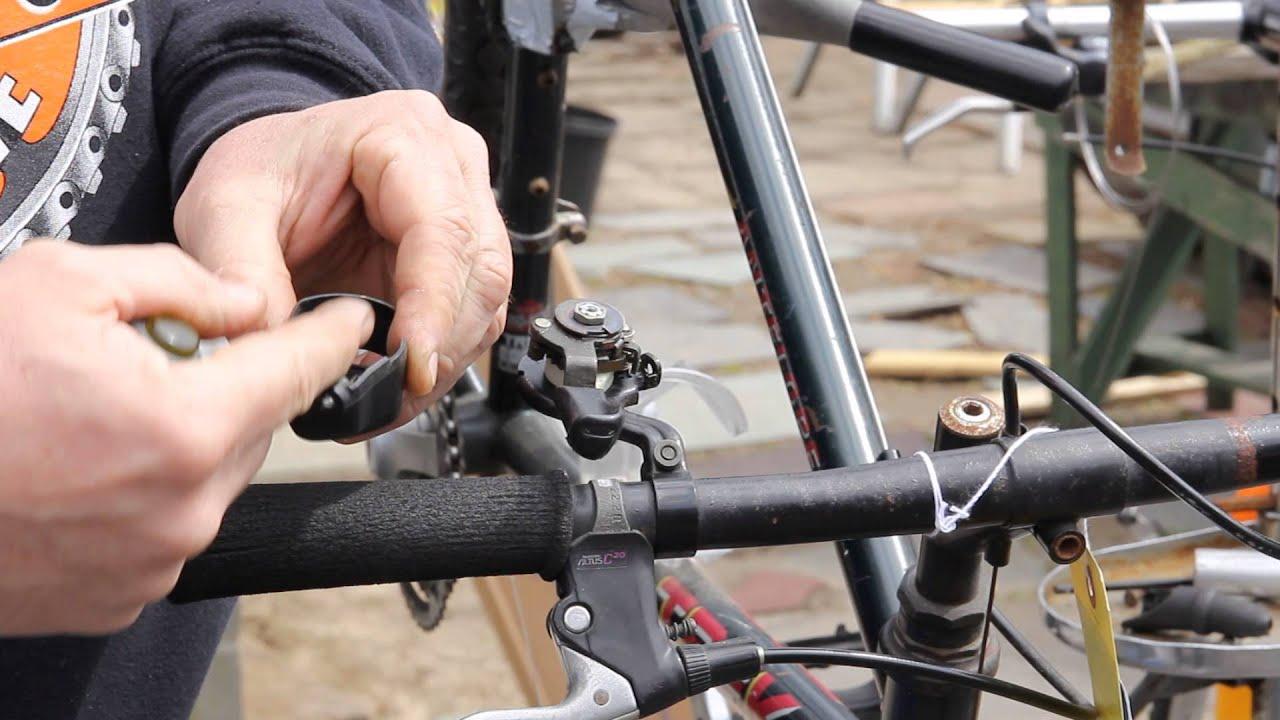 Removing a mountain bike grip shifter.
