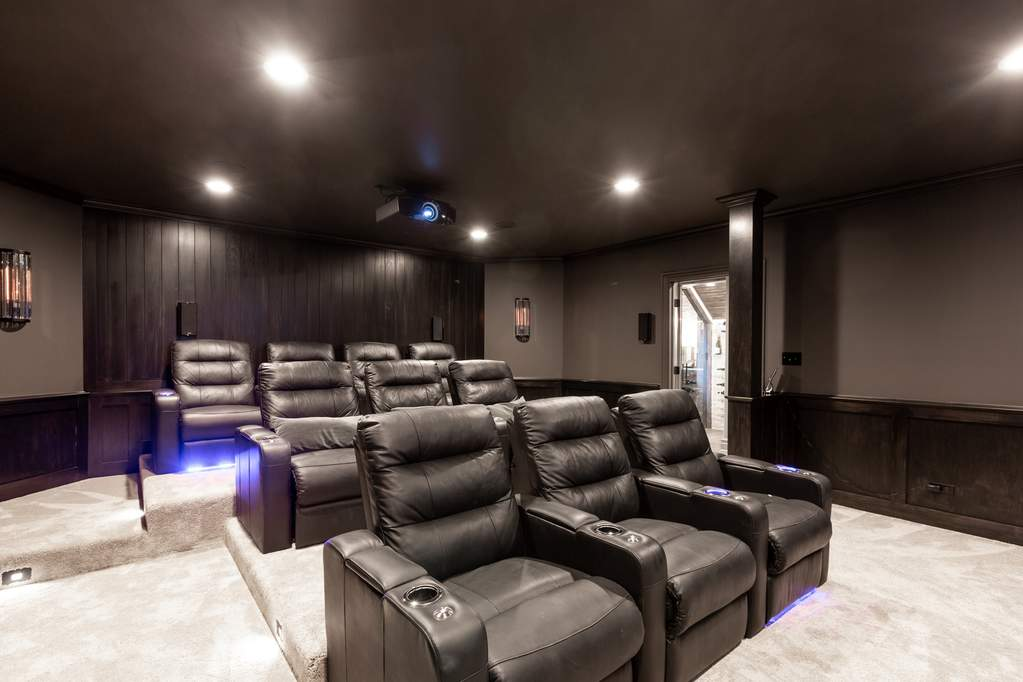 In-home Theater Tiered Leather Recliner Seating with under stair lighting