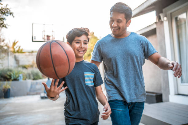 play catch with a basketball with parents