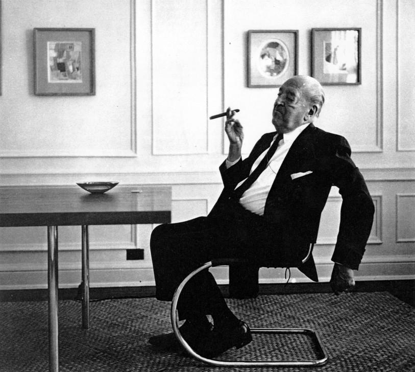 Mies van der Rohe sitting on Barcelona chair