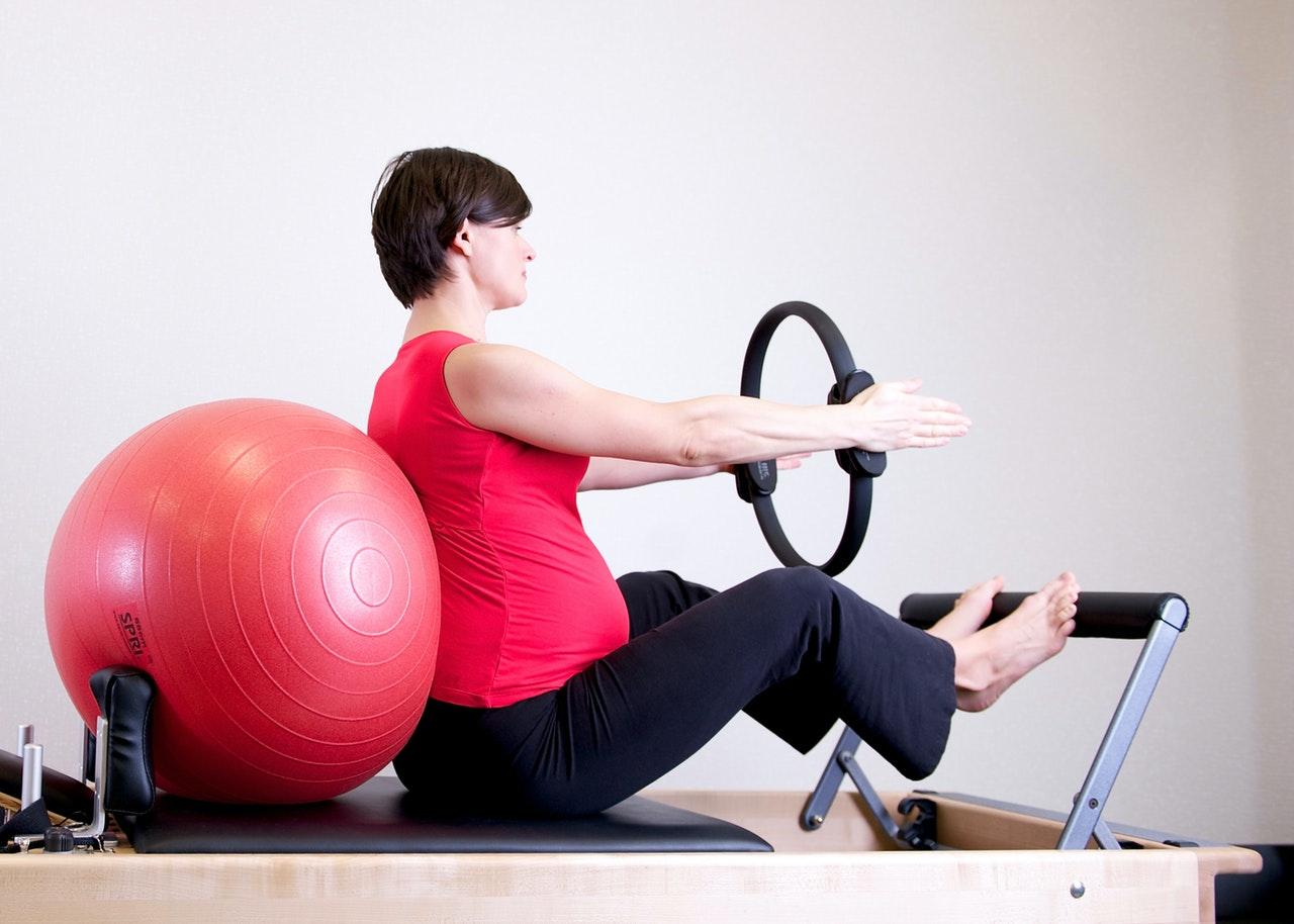 C:UsersWasifDownloadswoman-in-red-shirt-sitting-on-fitness-equipment-1103242.jpg