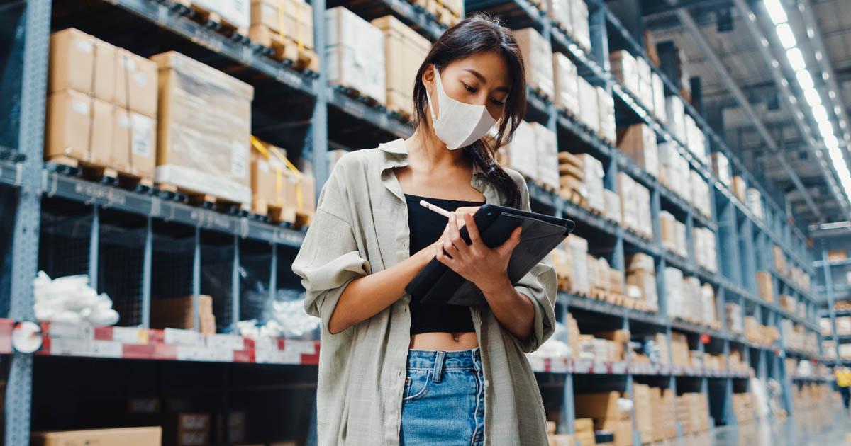 women writing down inventory
