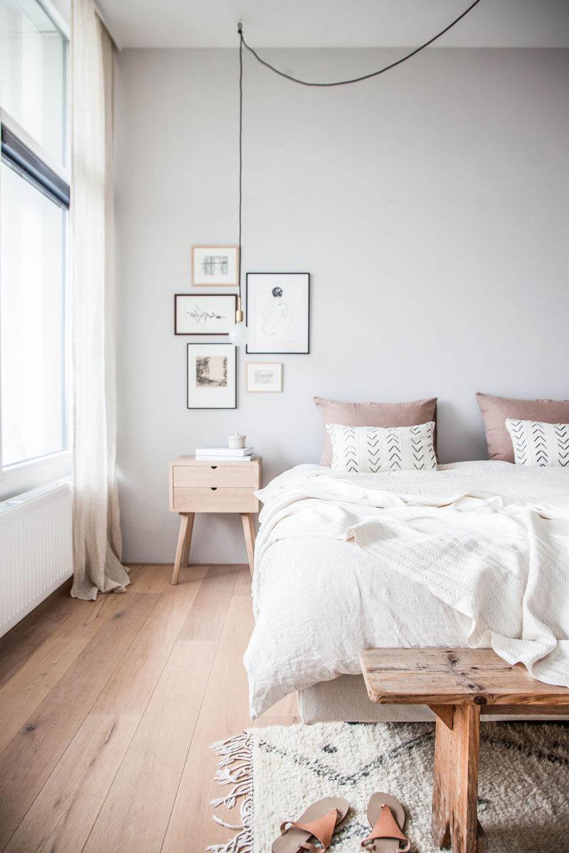 Penggunaan kayu alami pada lantai kamar tidur Scandinavian - source: contemporist.com