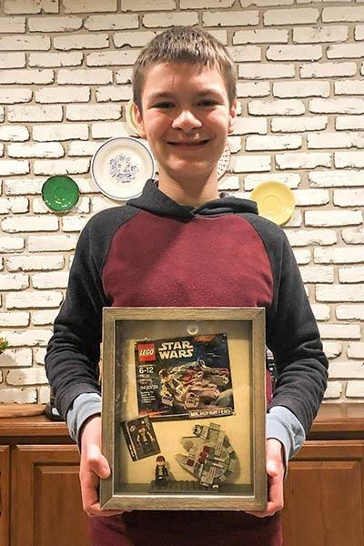 Haddon Haste, 12, of Louisville, Ky., broke a Guinness World Record by assembling a Lego Star Wars Millennium Falcon micro fighter kit in 1 minute, 59.72 seconds. Photo courtesy of Guinness World Records