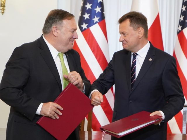 US Secretary of State Mike Pompeo (L) and Poland's Minister of Defence Mariusz Blaszczak greet each other with an elbow bump after signing the US-Poland Enhanced Defence Cooperation Agreement in the Presidential Palace in Warsaw, Poland, on August 15, 2020. - Pompeo is on a five-day visit to central Europe …