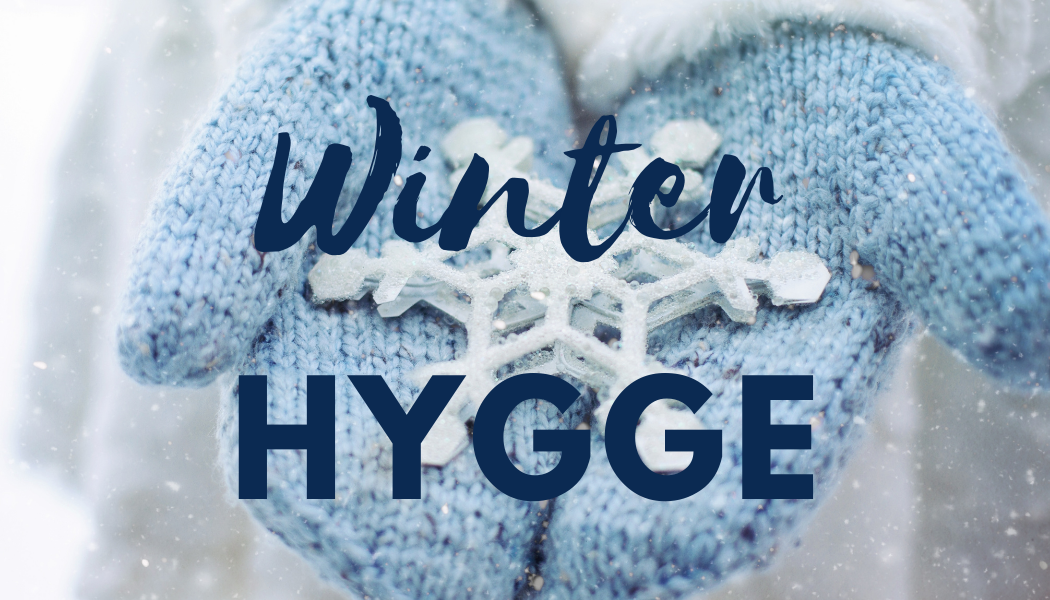 1,000 Hours Outside graphic: winter Hygge. Two blue mittens holding snowflakes.