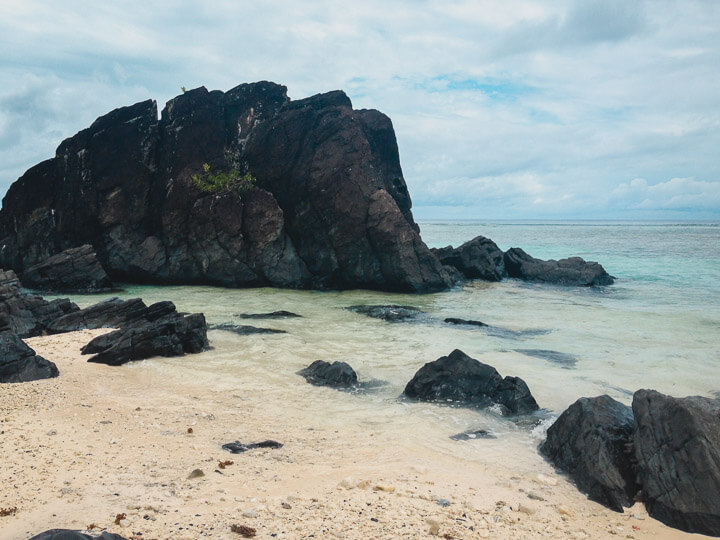 Black rock beach in Rarotonga