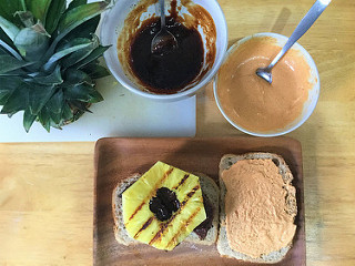 bbq tofu-pecan loaf sandwich with pineapple and smoky tahini sauce teaser.jpg