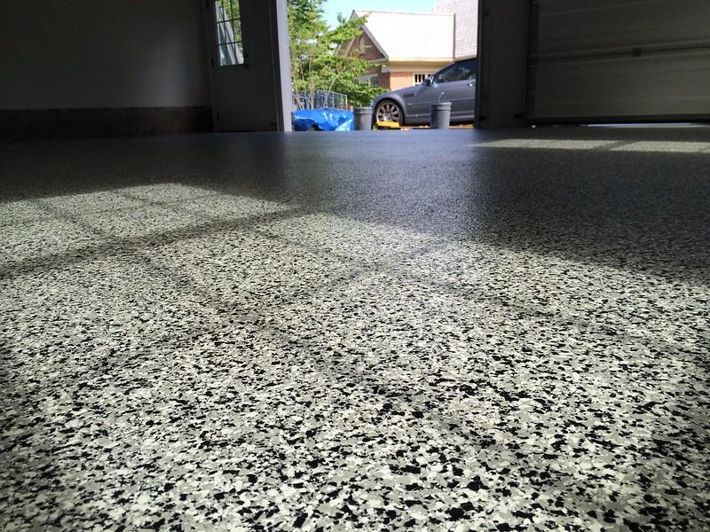 Applying new floor coatings for garage