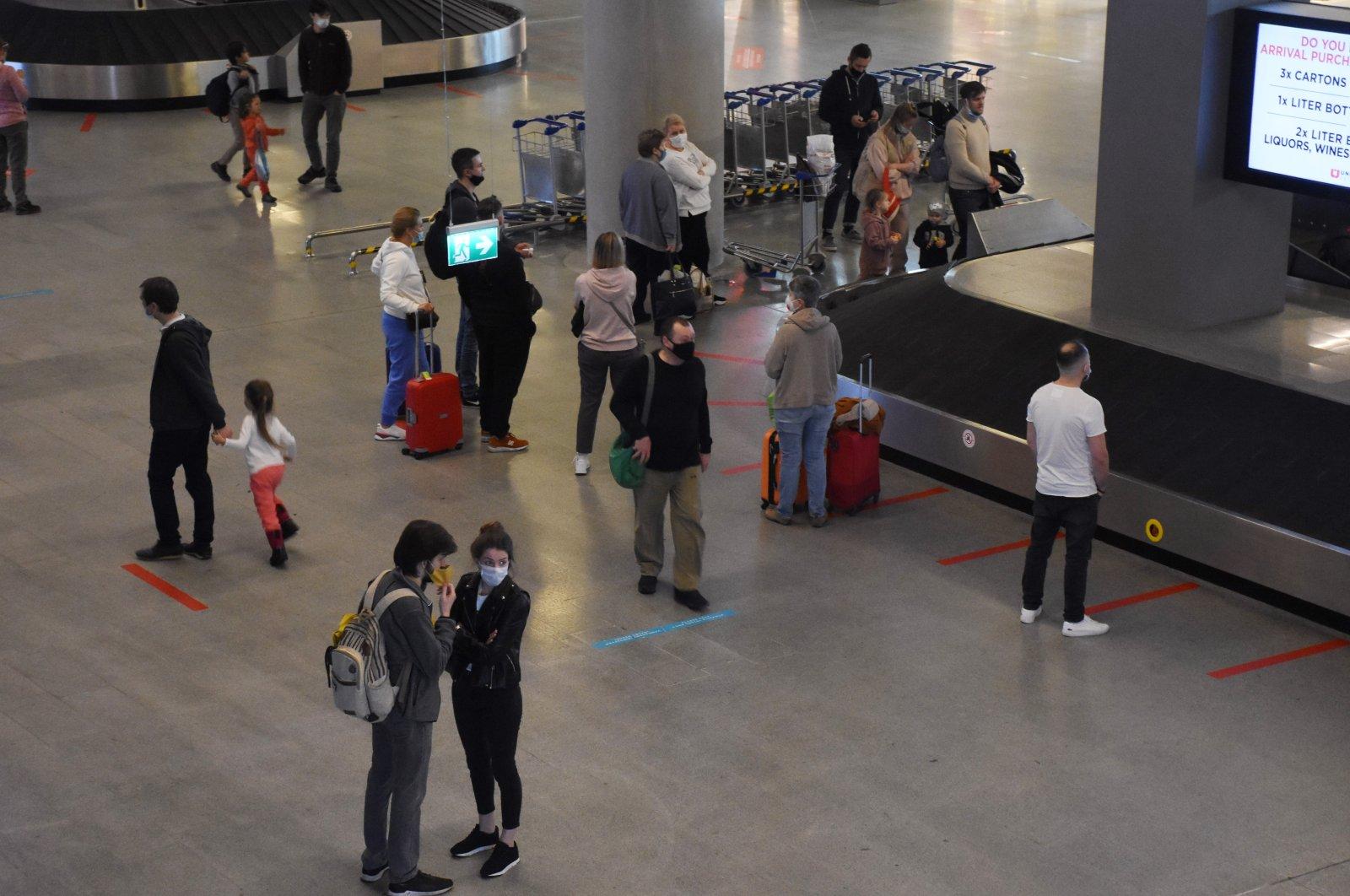 Tourists from the first plane of the season walk in Dalaman Airport, Muğla, southwestern Turkey, March 19, 2021. (AA Photo)