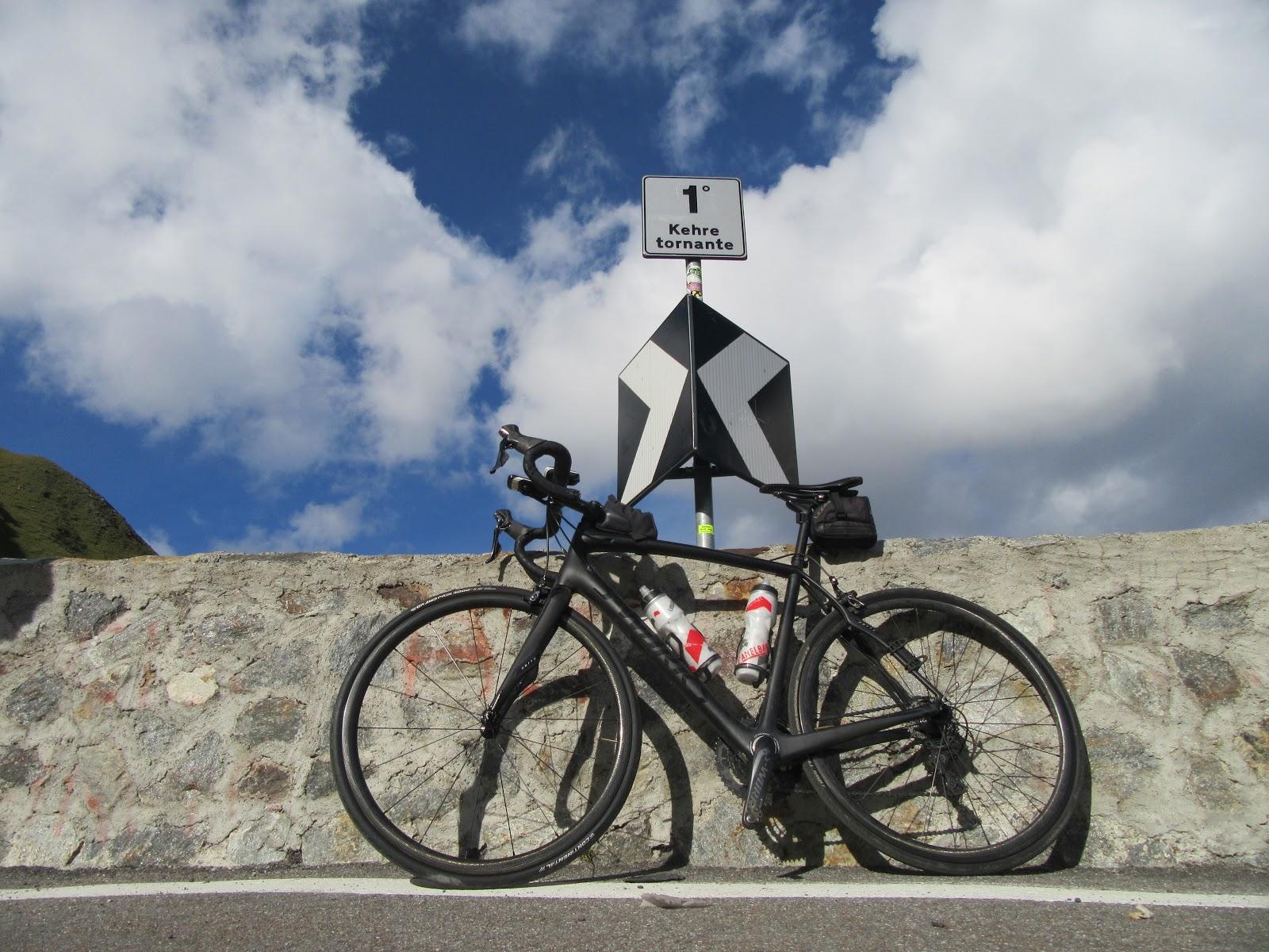 Cycling Stelvio from Prato - tornante (hairpin) #1 with bike below