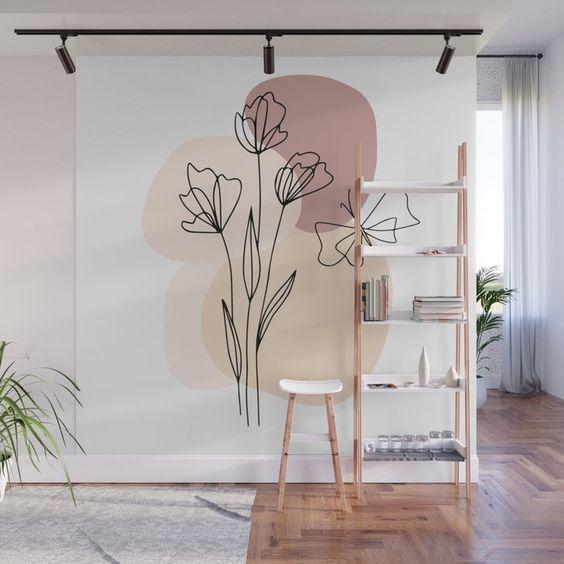 Parede com pintura orgânica, as formas descontruídas em cores sutis com o desenho da flor ao centro, deu um realce ao hall do apartamento.
