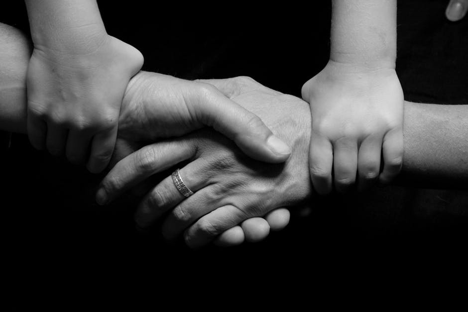 black-and-white, connected, hands
