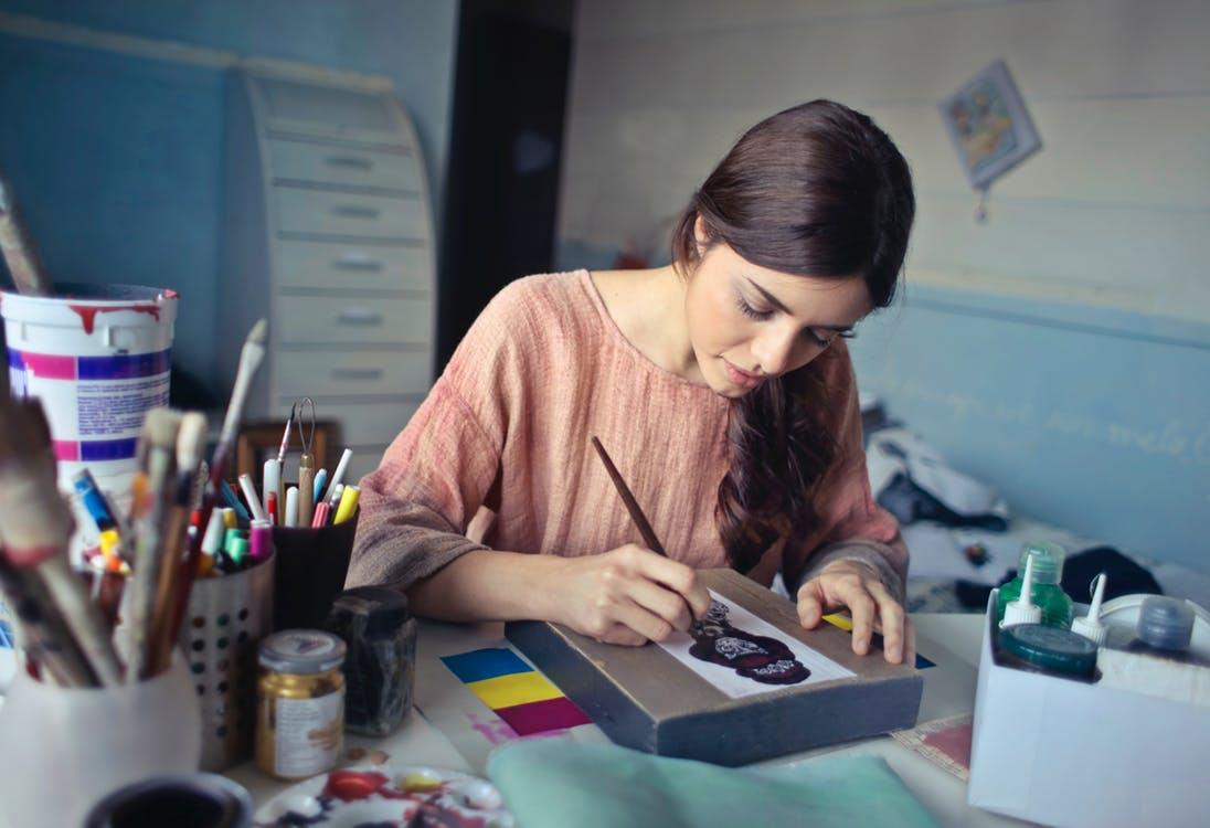 Woman in Brown Scoop-neck Long-sleeved Blouse Painting - logo