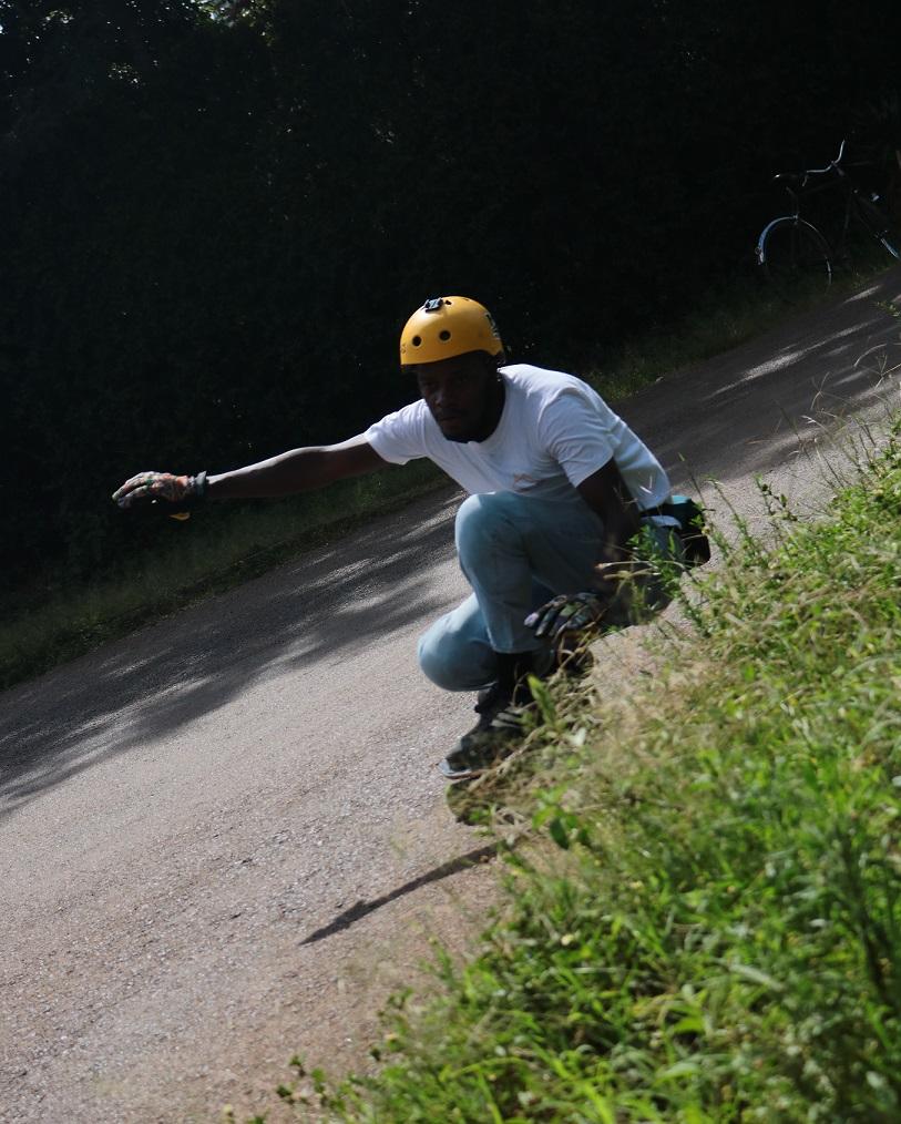 downhill skateboarding gripping a corner