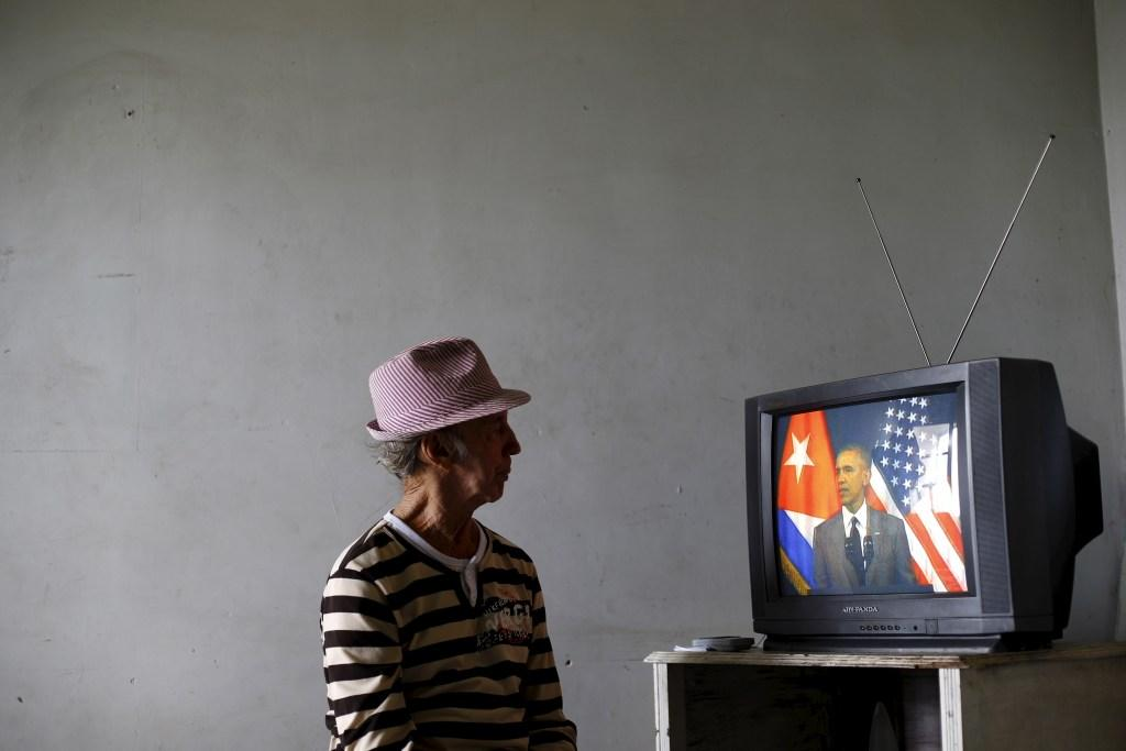 A man watches on television as U.S. President Barack Obama delivers a speech at the Gran Teatro de la Habana Alicia Alonso in Havana