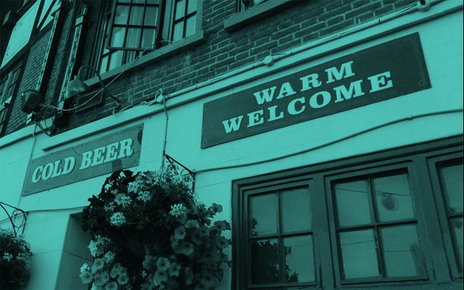 A pub offering a 'warm welcome'.