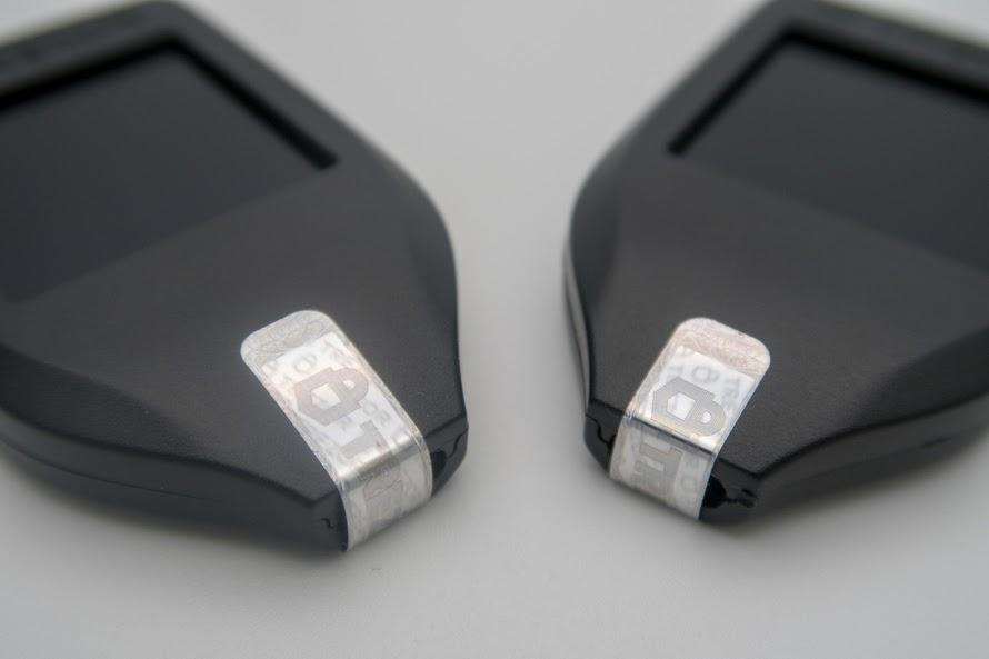 Photo of two Trezor Model T's highlighting the hologram seal still intact.