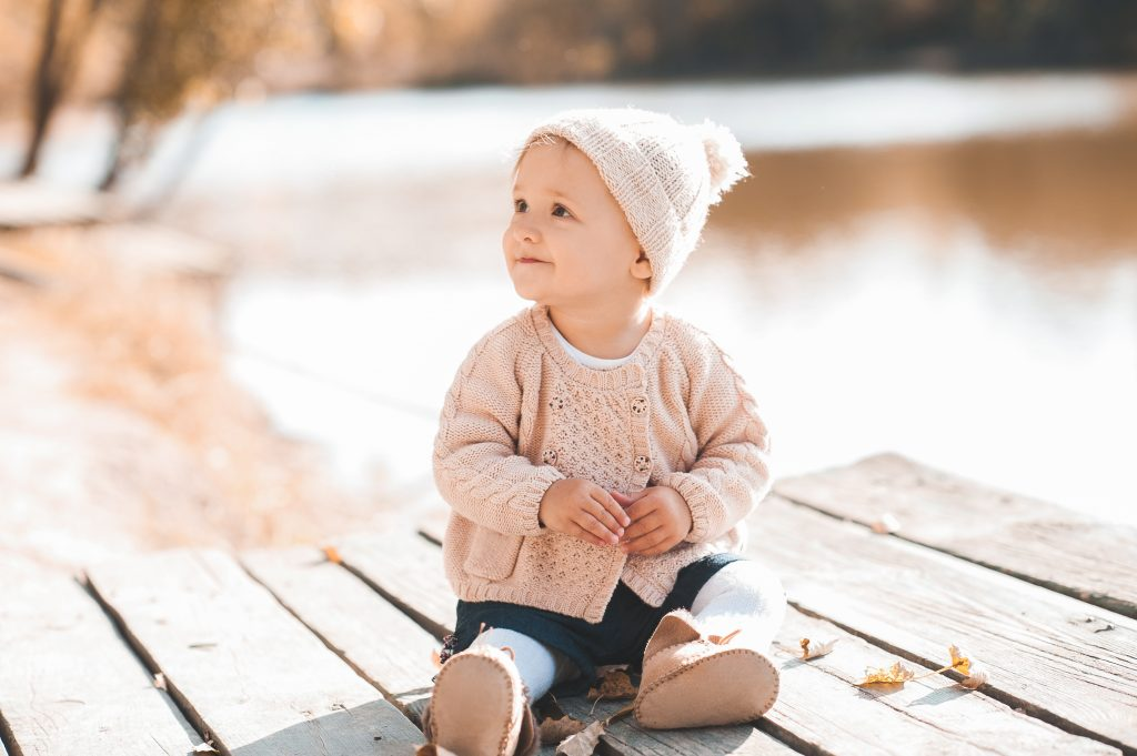 baby in cardigans