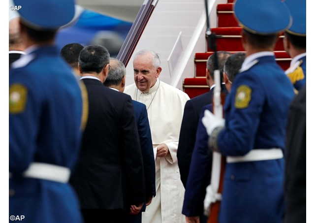 Pope Francis is received by Azerbaijan's authorities as he arrives in Azerbaijan's capital Baku, Sunday, 2 Oct 2016, for a 10-hour visit - AP