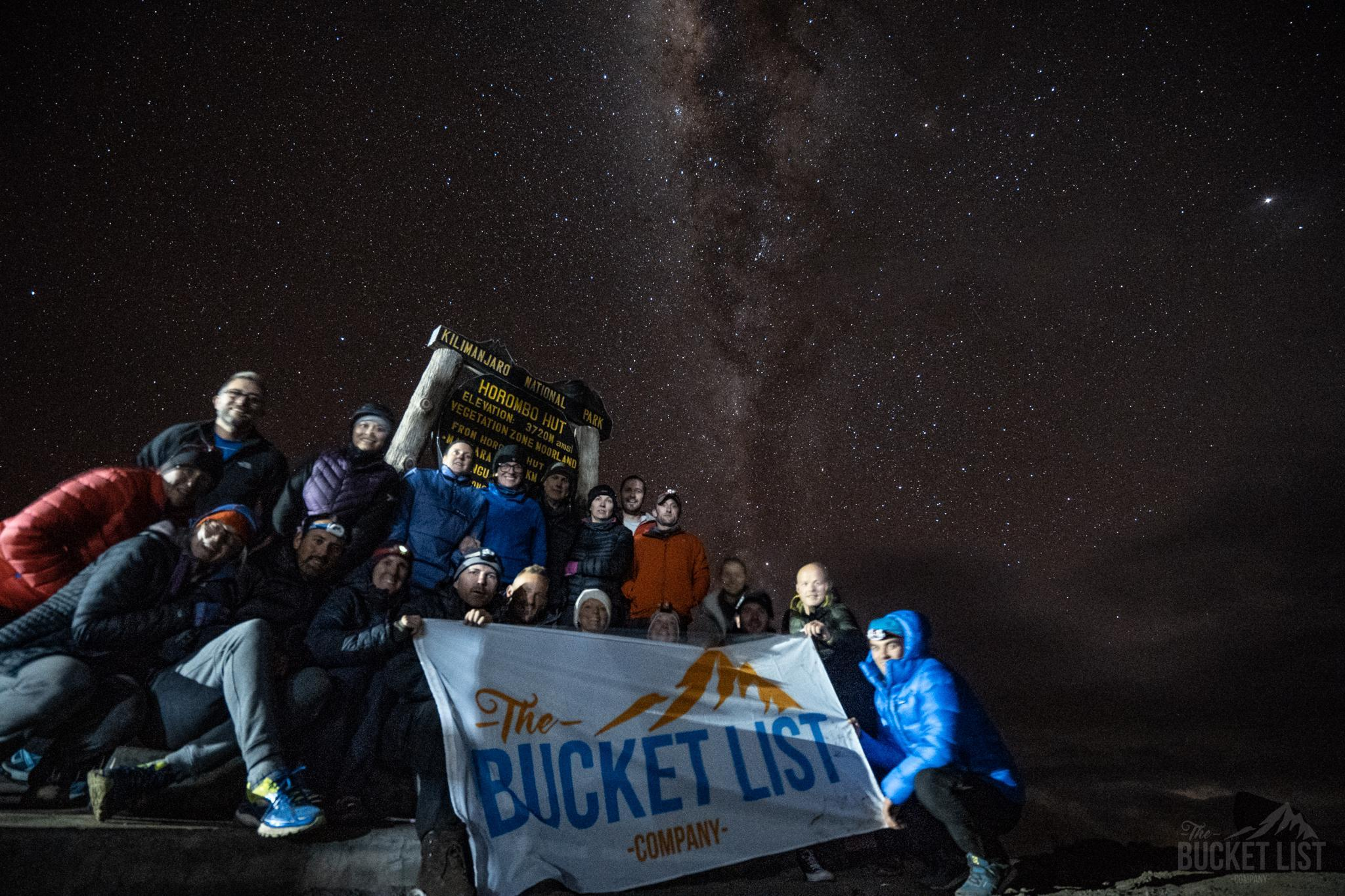 A group on Kilimanjaro with the Milky Way behind them