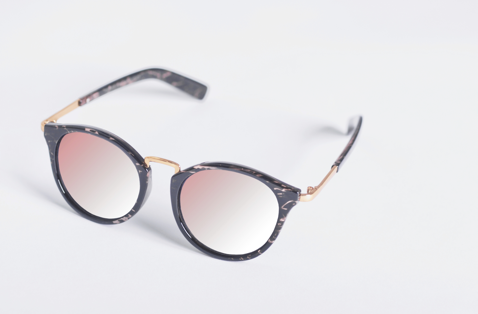 glasses with pink colour tint