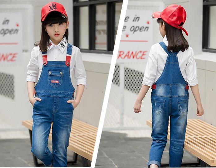 spodnie ogrodniczki jeansowe z dziurami dla dziewczynki11