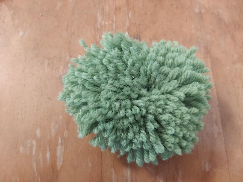 Raw pompom, needs trimming
