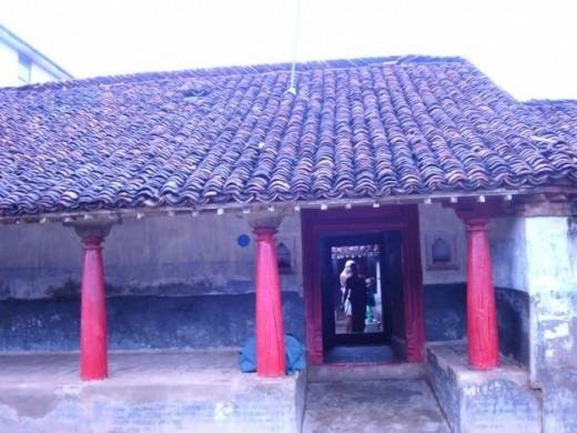 A typical village house of Tamil Nadu with earthen-tiled roofs. The platform outside is the 'Thinnai' where people sleep at summer nights.  The bright area seen inside the house is the 'mutram'. Thieves can climb over the roof and land there!