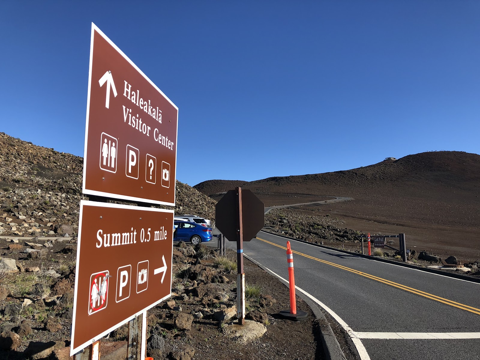 Bicycling Haleakala Volcano  - road sign to summit or observatories