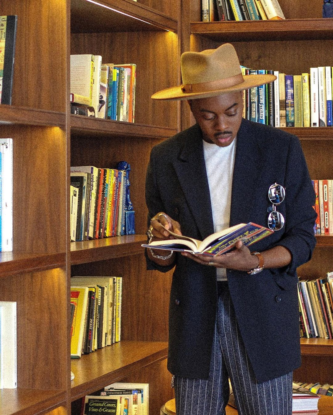 A man reading a book in the Betsy Hotel's library