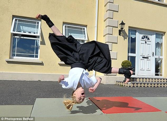 Upside down: Jesse Jane flies through the air