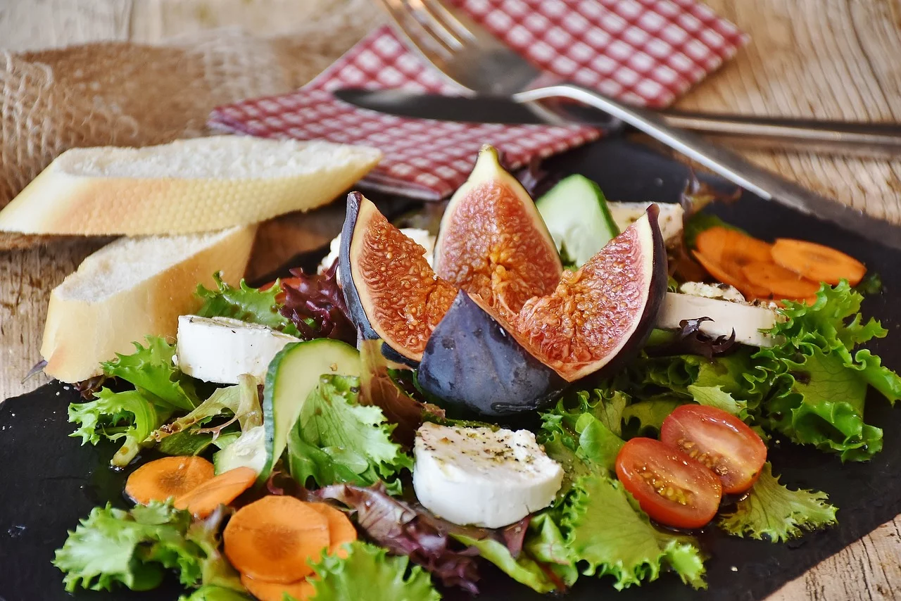 Healthy salad, fig, bread, cheese