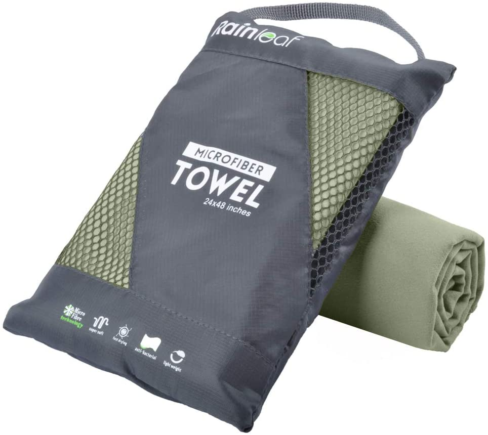 Travel towel bag and rolled up travel towel underneath it.