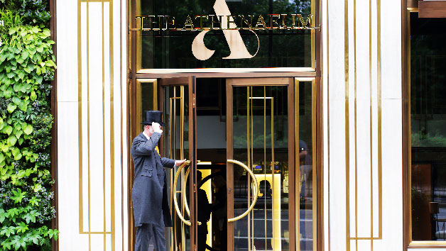 Man opening the doors to The Athenaeum Spa Hotel