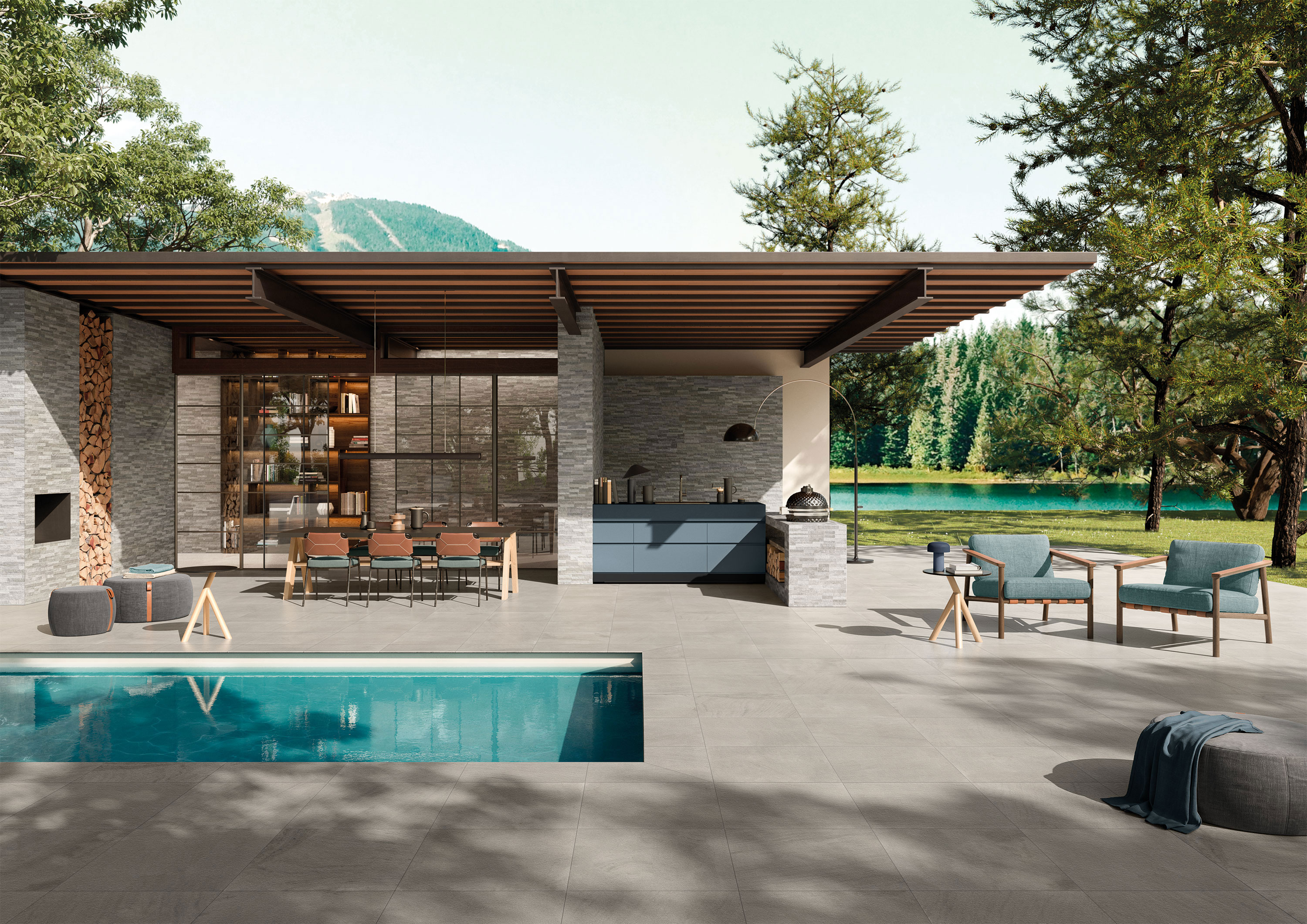 Outdoor kitchen with concrete-look tile flooring and pool surround