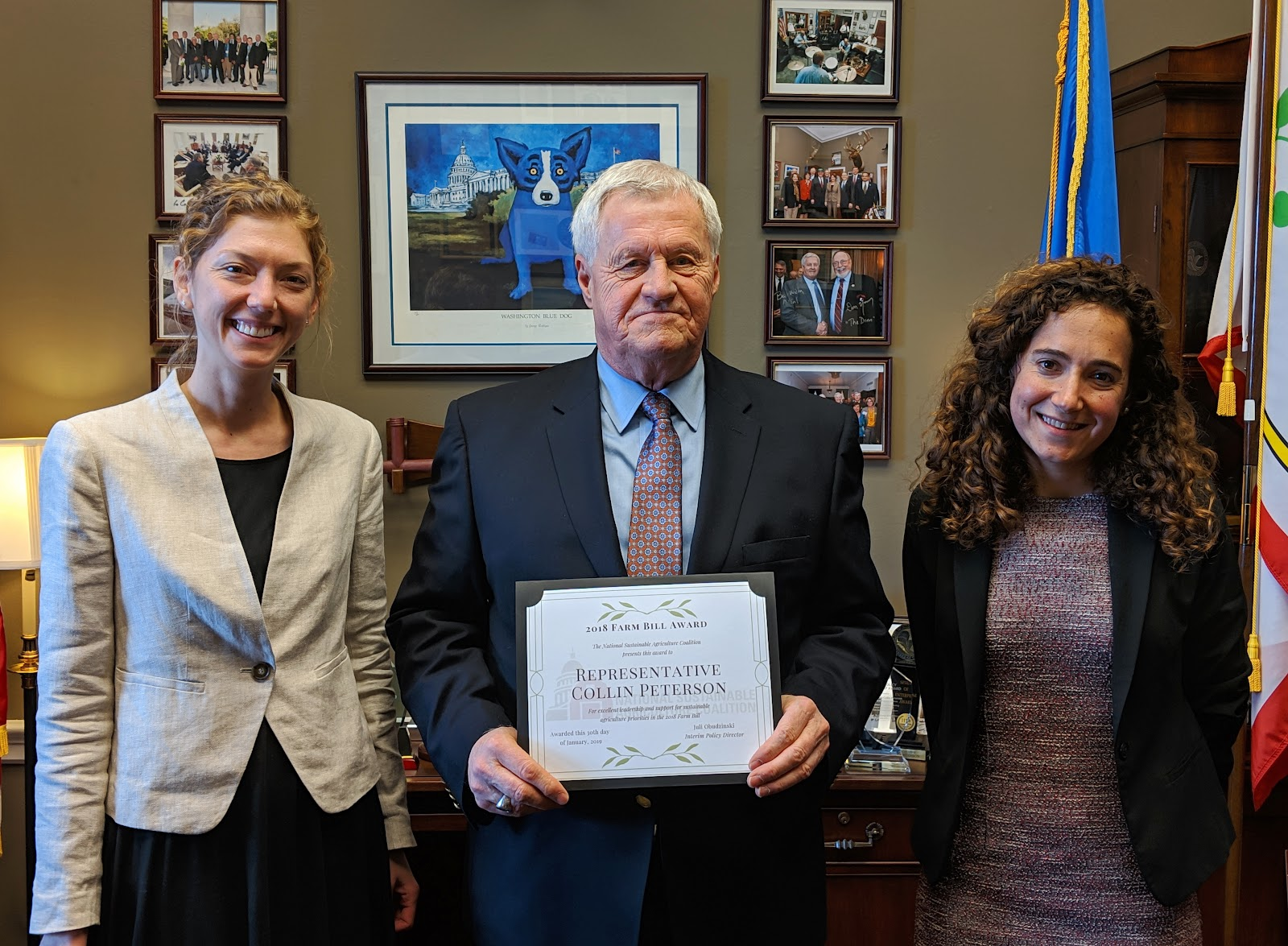 Representative Peterson (D-MN) - champion for bipartisan farm bill, is presented with a 2018 Farm Bill award by NSAC staff member Alyssa Charney, and NSAC Coalition member Tara Ritter with the Institute for Agriculture and Trade Policy