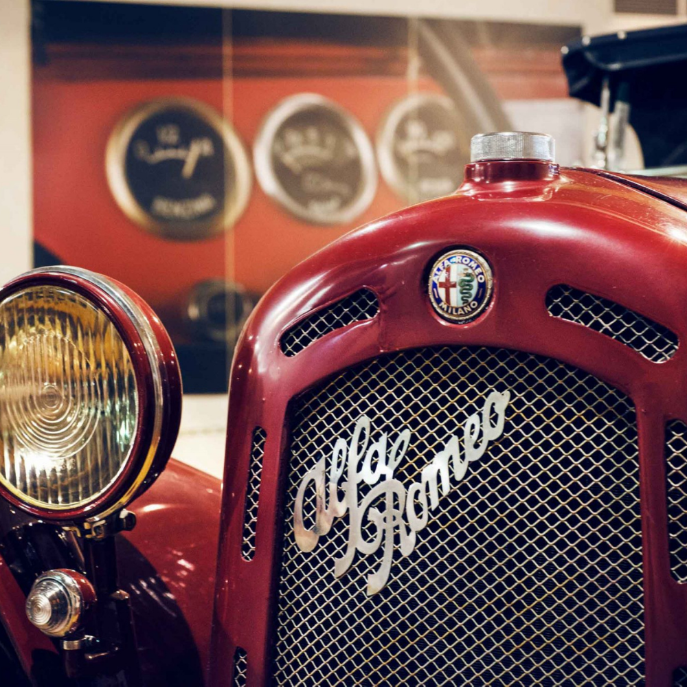 A red Alfa Romeo car in the Alfa Romeo Museum