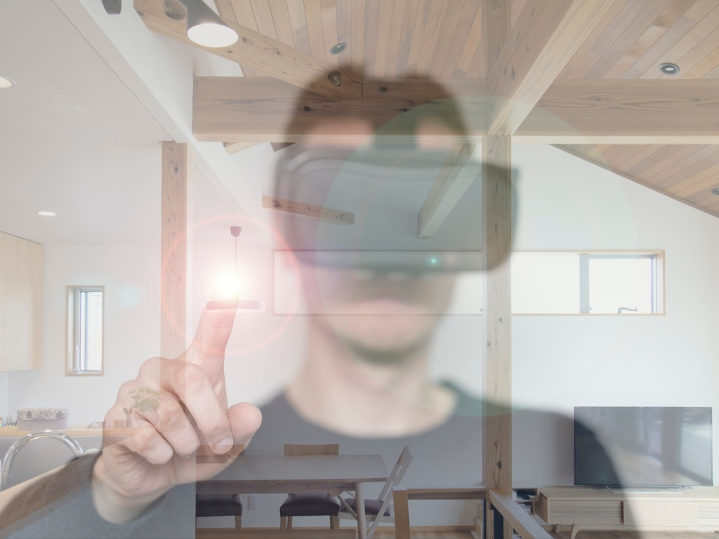Virtual Reality headset overlaid man pointing in room, half opacity