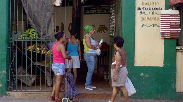 Women queuing up at a market stall