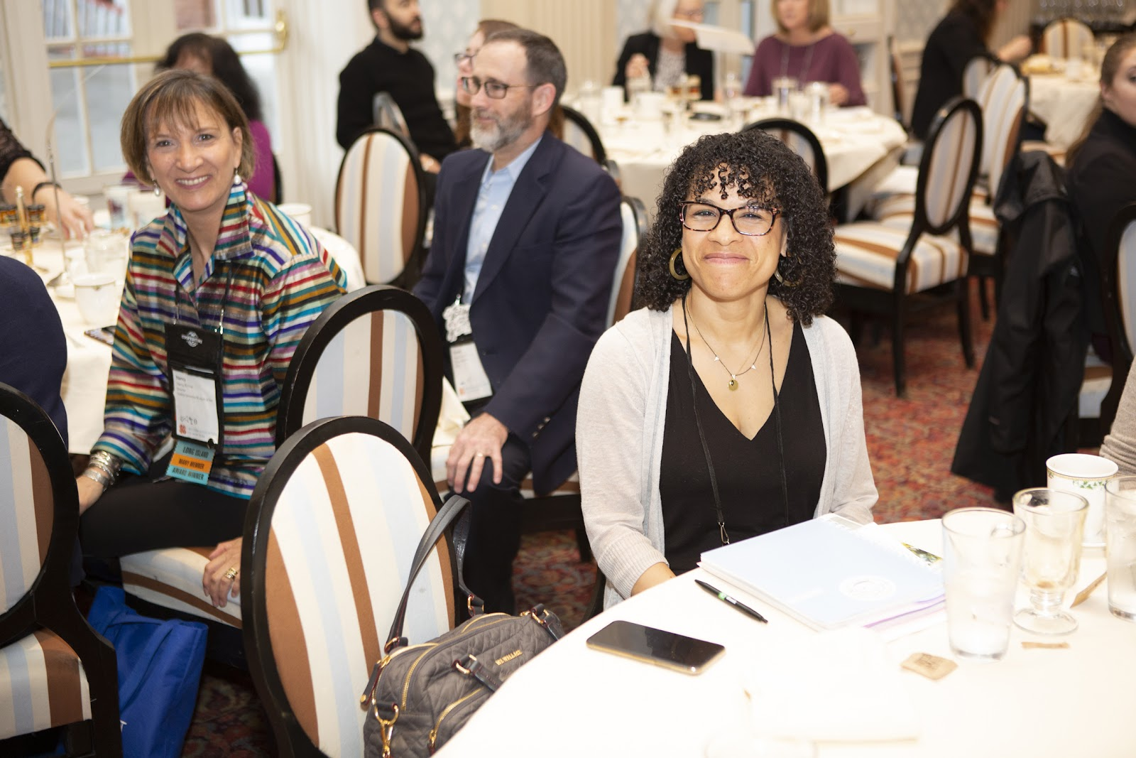 Meredith Horsford, Executive Director of the Dyckman Farmhouse Museum sitting at a table at the Otesaga Resort Hotel during the 2019 annual conference in Cooperstown, NY