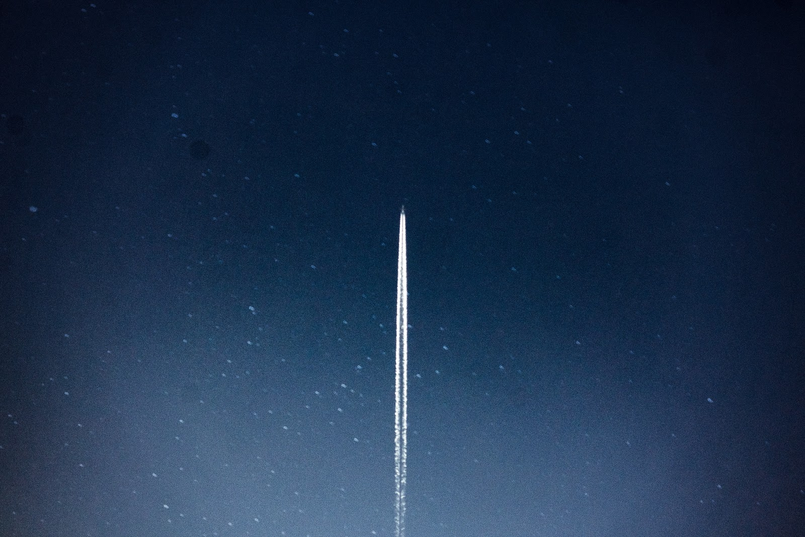 A rocket ascends
