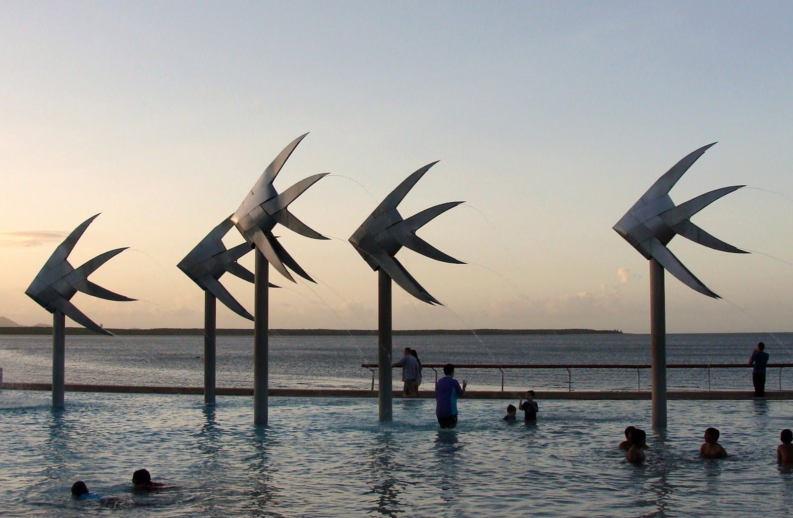 the-lagoon-on-cairns-esplanade-at-sunset-in-queensland-australia.jpg