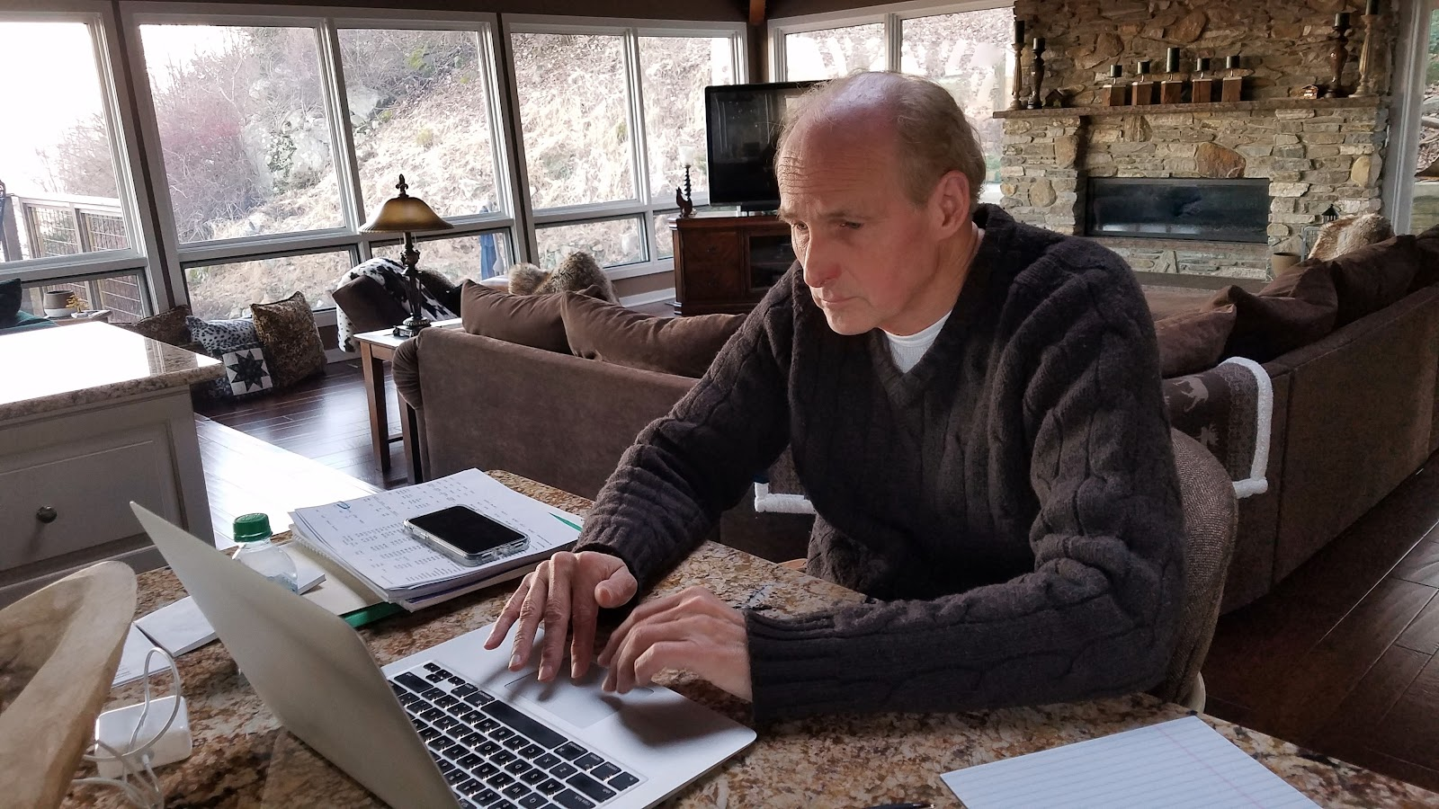 A man working from home on his computer